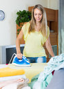 Girl ironing at home Royalty Free Stock Photo