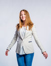 Girl in jeans and beige jacket, woman, studio shot Royalty Free Stock Photo