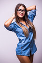 Girl in jeans shirt with glasses posing with different gesture in studio Royalty Free Stock Photo