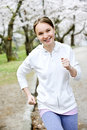 Girl jogging in park Royalty Free Stock Photo