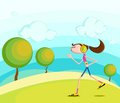 Girl jogging in park while listening music Royalty Free Stock Photo