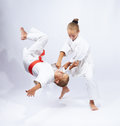 The girl in judogi throws the boy Royalty Free Stock Photo
