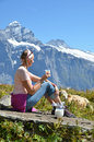 Girl with a jug of milk and a cow jungfrau region switzerland Stock Images