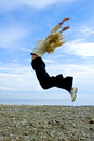 Girl jump above Baltic sea Royalty Free Stock Image