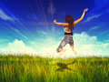 Girl jump in a sunny grass field d jumping under blue sky background Royalty Free Stock Image