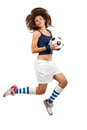 Girl jumpig with soccer ball in mid air over white background Stock Image