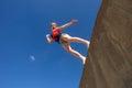 Girl jumping blue sky teen off wall in on beach park hour Stock Photos