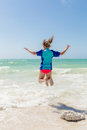 Girl jumping in the ocean Royalty Free Stock Photo