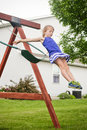 Girl jumping off swing Royalty Free Stock Photo