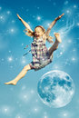 Girl jumping over the moon Royalty Free Stock Photos
