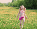 Girl jumping over a skipping rope outdoor Royalty Free Stock Photography