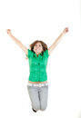 Girl jumping with raised arms up of joy excited isolated on whi pretty woman or white background in green shirt and gray jeans and Stock Photo