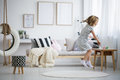 Girl jumping in room Royalty Free Stock Photo