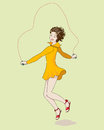 Girl jumping rope in yellow dress is Stock Image