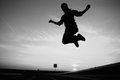 Girl jumping silhouette of a sky background Stock Image
