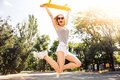 Girl jumping with skateboard Royalty Free Stock Photo