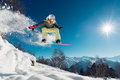 Girl is jumping with snowboard Royalty Free Stock Photo