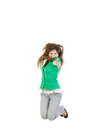 Girl jumping with thumb up of joy excited isolated on white ba pretty woman or background in green shirt and gray jeans casual Royalty Free Stock Image