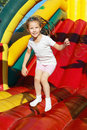 Girl jumping on a trampoline Stock Images