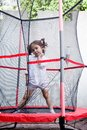 Girl jumping in the trampoline little on Royalty Free Stock Photography