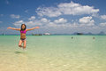 Girl jumping in the water at the beach of the Koh Ngai island Th Stock Photos