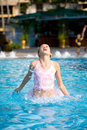 Girl jumps out of a swimming pool Royalty Free Stock Photo