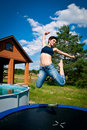 Girl jumps on a trampoline Royalty Free Stock Photo