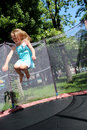 Girl jumps on the trampoline Royalty Free Stock Photo