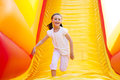 Bouncy Castle. Summer Rest. Cheerful Girl And Her Dog. Bouncy Castle Rental.