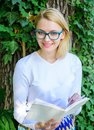 Girl keen on book keep reading. Woman blonde take break relaxing in park reading book. Bookworm student relaxing with Royalty Free Stock Photo