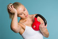 Girl and kettlebell Royalty Free Stock Photos
