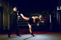 Girl kicking back leg during kickboxing practice Royalty Free Stock Photo