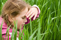 Girl kid looking for in the grass Stock Images
