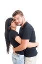Girl kising boy on the cheek white studio background Stock Image