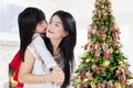 Girl kiss her mother from back Royalty Free Stock Photo