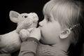 Girl kiss toy bear Stock Photos