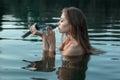 Girl kisses a fish. Royalty Free Stock Photo