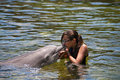 Girl kissing dolphin Royalty Free Stock Images