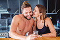 Girl kissing her boyfriend in the kitchen Royalty Free Stock Photo