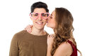 Girl kissing her boyfriend Royalty Free Stock Photo