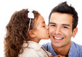 Girl kissing her father Royalty Free Stock Photography