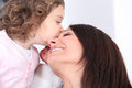 Girl kissing her mother Stock Photo