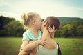 Girl kissing her mother Royalty Free Stock Photo
