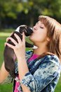 Girl kissing her puppy Royalty Free Stock Photo