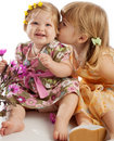 Girl kissing her sister Stock Images