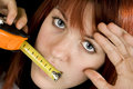 Girl kissing measuring tool Royalty Free Stock Image