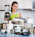 Girl with kitchen appliances at home Royalty Free Stock Photo