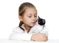 Girl and kitten little tenderly embraces a Stock Photos