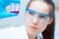 Girl laboratory assistant checks samples in medical lab a Royalty Free Stock Photos