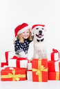 Girl with labrador dog are wearing christmas hats Royalty Free Stock Photo